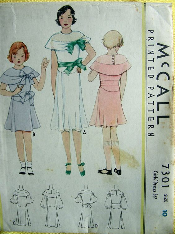 From the 1920s. The cape like mantel and the placement of the waist look strikingly like the dress of our time traveler.